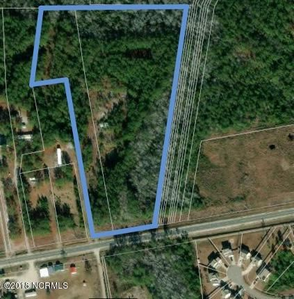 This 12.12 acre parcel on Highway 172 in Sneads Ferry is calling to be rezoned for medium-high density residential development. Current zoning allows for 12 (1) acre homesites, and R5 (max 10 units per acre) is just across the street.   Call to discuss and for preliminary site plans. . Highway 172 is the main road to the Sneads Ferry gate at Camp Lejeune, about a 10 minute drive.  The perfect recreation destination, North Topsail Beach of course, is also just a 10 minute drive. Water and sewer are located just down Highway 172 at the Oyster Landing development, where homes are selling in the mid $200k's on .33 acres. There is a mobile home with no value on the property.  The parcel also features a pond.