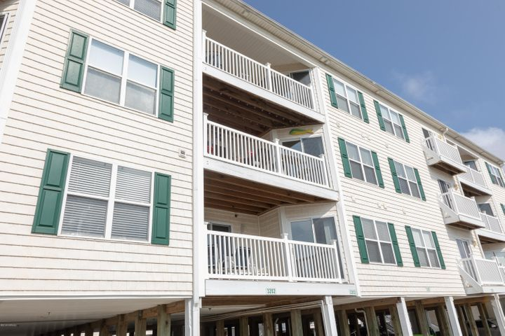 3 bedroom, 2-1/2 bath condo on Oak Island with spectacular ocean views!  The open floor plan, modern kitchen and bar area are perfect for entertaining,  And, there are balconies off the living area and the master bedroom that offer views of Oak Island Beach.  This property is just steps away from the beach, walking distance from shopping and dining, and a short drive from charming downtown Southport.  It would be an appealing investment property, a great getaway, or a perfect primary home. Steps from the beach, along with a short bike ride or stroll to dining and entertainment coupled with the availability of a short drive to downtown Southport for additional dining and entertainment make this condo a great getaway as a second home, a primary home, or appealing investment for additional income.
