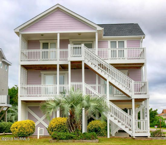 Excellent investor opportunity and perfect family beach retreat. Smell the sea, feel the breeze, and savor the ocean, canal, or sugar sand views from all rooms or one of the 4 separate exterior decks or cozy 2nd floor sunroom. With boardwalk beach access just steps out the front door, access to the unspoiled and family friendly Holden Beaches is easy and fast. This ''reverse floor plan'' home provides convenient multiple entrances on both living levels. Level 1 welcomes guests with an easy-care ceramic foyer with central hall access to both guest bedrooms and convenient hall bath, and the Master Suite. New and durable Berber style carpets welcome guests upstairs to the Great Room heart-of-the-home.
