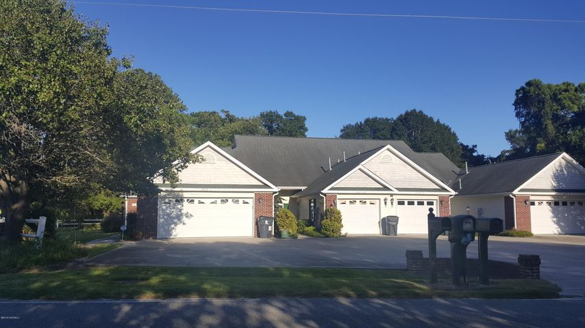 Truly one of the prettiest duplex/townhomes in Brunswick County under 170K, only one block away from the Intracoastal Waterway and only 3 miles from Sunset Beach traveling South and 3 miles from Ocean Isle Beach traveling North. 30 golf courses within 5 minutes to 30 minutes from home. 3 bedrooms, 2-car garage, fenced yard, only 125.00 monthly dues for landscaping and exterior work. BIG kitchen with granite counter tops, big laundry room, 2016 New refrigerator and gas stove, New gutters, many upgrades, plus fireplace and office to boot. This is a fantastic duplex on ground level with NO steps to climb and within 1/2 mile form grocery store, banks, restaurants, retail shopping, gas station, post office,  and more. This lovely corner unit will not last long. BOOK YOUR APPOINTMENT TODAY!