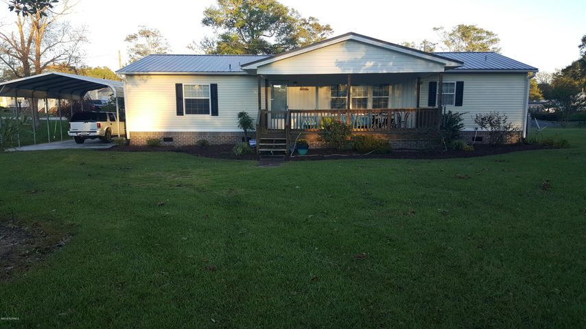 BEST BUY! Squeeky clean & Perfectly Perfect Permanent or vacation home across from Holden Beach in lovely West Tanglewood Subdivision with private Boat launch & fishing pier for under 136K. Decorated in tasteful Coastal Living comfort with soft pallet of wall colors. Nicely Furnished with view exceptions, new Serta Perfect Sleeper 1,400 king mattress in master bedroom, new HVAC, new seamless roof, carport with concrete floor, shed with concrete floor for 48'' cut riding lawn mower that conveys, new  covered front porch, & uncovered back porch for grilling with Char-Broil stainless grill which conveys, whole house gutters, lovely yard & landscaping. & only 2 blocks to the Intracoastal Waterway were you can launch your fishing boat or kayaks or jet skis,taxes only 496 year. POA 150 year.