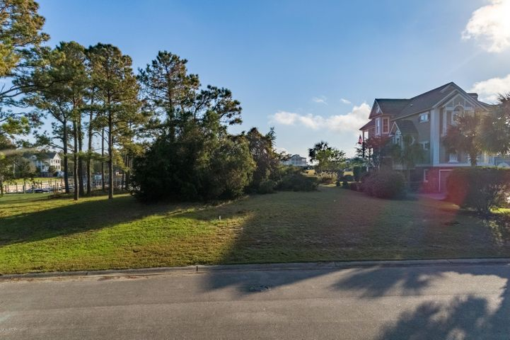 Lovely waterfront lot in the gated, quiet Seascape Community overlooking the marina. Perfect for the boat lover who enjoys looking out from their dream home to see their boat in their own deeded slip. Community offers many amenities such as clubhouse, pools, trails, fitness center, as well as essentials like water, sewer, maintenance of all common areas, plus security. Located a short drive from Holden Beach (where you can also enjoy the POA's private beach house) as well as Myrtle Beach and Wilmington. Please note that property listing includes lot AND slip, although both are available for individual purchase, boat slip must be owned by a property owner in Seascape.