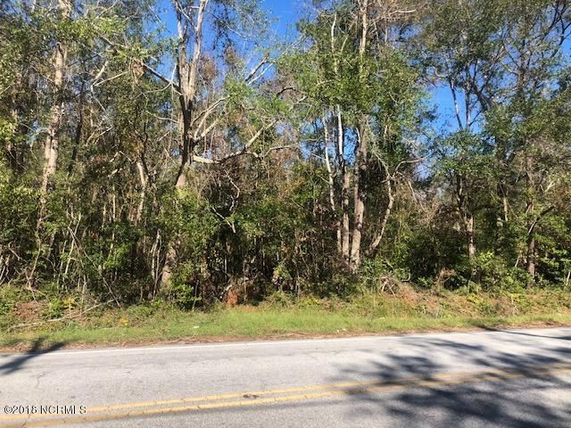 This is a lovely plot with 4.07 acres close to Hammocks Beach State Park. The natural pond is located to the side of the lot allowing plenty of building space along with the beauty of this natural area.There is a path to the left with easiest access to walk onto the lot. There is an area that had been cleared that is an easy walk to see the natural pond on the property.