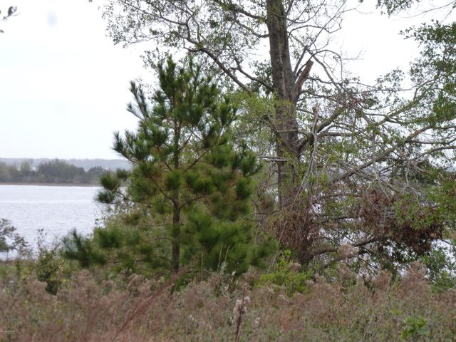 2+ acre building lot with water views in Swansboro. Close to Hammocks Beach State Park and just outside of the city limits. The building site is on high ground and in flood zone X.