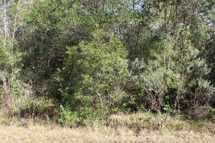 Lot in Ocean Aire Estates great for modular or manufactured home just minutes from Ocean Isle Beach, near Shallotte and neighborhood grocery stores.