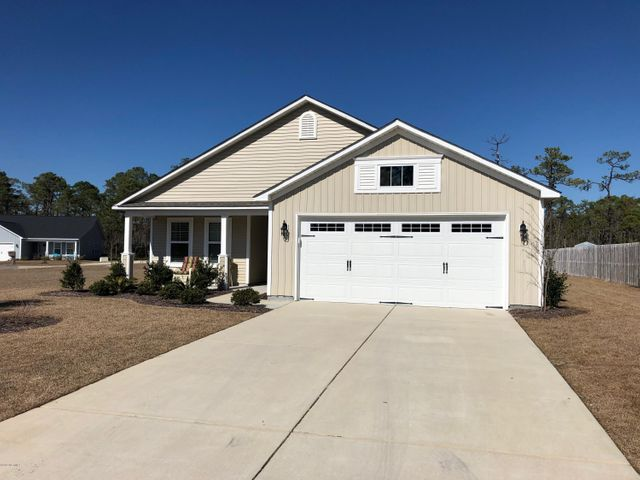 Why build when you can get a nearly new home with updated window treatments and laminated wood flooring throughout, with convenient access to both the Oak Island Beaches and Historic Downtown Southport?  This corner lot home, one of the largest in the subdivision, has an inviting, informal feel which makes it easy to live and entertain in. The front entrance leads to a spacious living room with cathedral ceilings.  The open kitchen set off to the right gives way to a dining area which overlooks a screened in patio space and backyard.  There is a large storage shed just outside of the house and plenty of yard space for outside entertaining or play area for children. In between the kitchen and the garage is a laundry room with a washer/dryer and shelving on one side and a large double door closet on the other, which can be used as a pantry or additional storage.  The two car garage has been extended out 3 feet, to give room for a workbench or bicycles. There are two bedrooms to the left of the entrance with a full bath in between. The master bedroom is set off to the back of the house, allowing for privacy from guests or other family members. The master bedroom is large enough to include a study area or additional furniture such as a reading chair or loveseat.  The master includes a large bath with both a stall shower and tub, along with two walk in closets.  This home is close enough to conveniences such as movies, groceries, and shopping, yet tucked away in a quiet residential street.