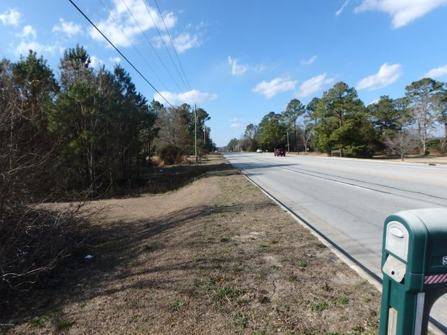 Amazing opportunity 24.68 acres of land directly off Hwy 24/258 (Richlands Hwy)  in between Jacksonville and Richlands. 68 feet of road frontage.   (tax parcel ID#434903334891)    Buyer to verify Schools.  This parcel is combined PIN/PIDs:  4349032311544 and 434903233952  Don't miss out on this great deal!