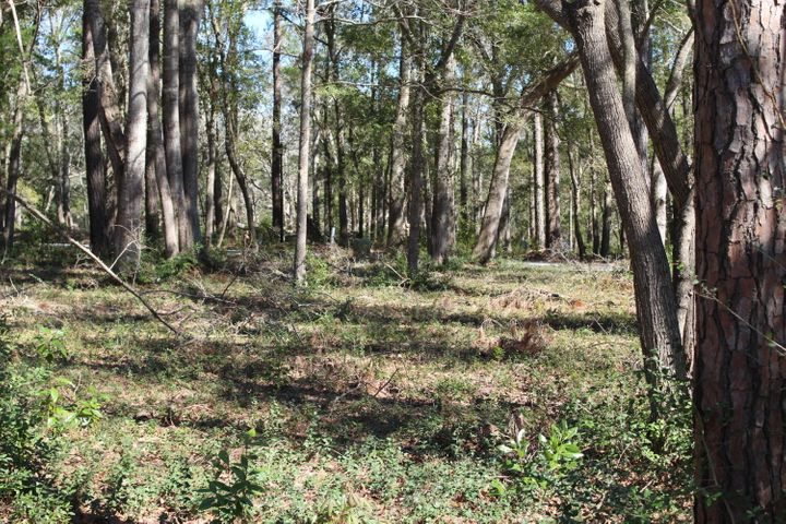 Choice Home Site with Panoramic Views of the Shallotte River and located next to the River Bluff community boat launch and dock.  A community pool is also part of the amenities.     This is a dream lot for your dream home.