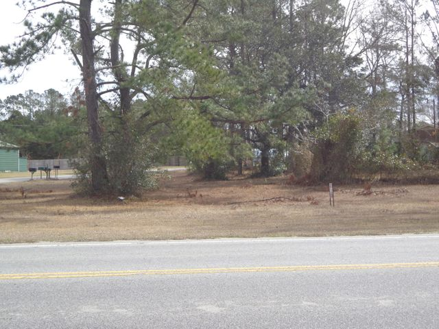 Nice corner commercial lot -- .50 acres , Corner of Trout & Ocean Road ( Hwy 50 ). Residential water tap has been paid for this lot. Lot beside this lot .53 acres is available for $90,000. Both lots zoned 'NB' - Neighborhood Business. Water & Sewer available for both lots.