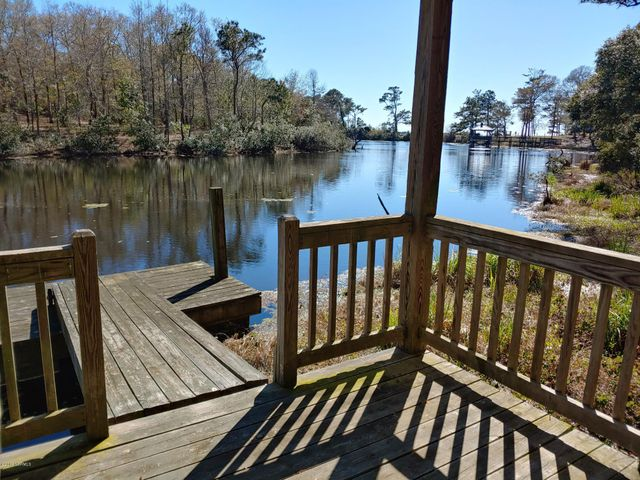 Beautiful lot with water view and water access from the gazebo right in the back yard.  Located in the gated community of Oyster Harbor, with many amenities including boat ramp to the ICW, boat storage area, kayak launch to river, club house, pool, tennis courts, fitness center, fishing pier in fresh water lake. minutes to Holden Beach.