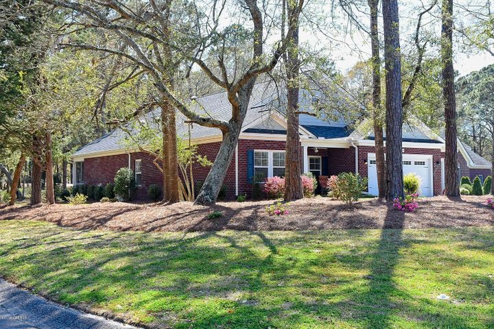 Pretty Perfect is best description for this 3 yr. young handsome custom brick home in 5 star condition in prestigious Gated community of Brick Landing Plantation, a gated golf & water front community.  large corner homesite with backyard looking at tee box of number 5 fairway. 100% of This entire home-all rooms, bathrooms,closets, garage, everything is handicap accessible. Beautiful cabinets & granite in BIG kitchen-Den Combination with 11' ceilings & gas fireplace, Oak hardwood floors in main living areas and carpet in 3 bedrooms. trey ceiling in Large Master suite & bathroom with man size shower and tremendous walk in closet.  wonderful storage, two pantries, floored attic storage, walk to club overlooking Intracoastal Waterway. ONLY 3 miles to Ocean Isle Beach & 1 mile to NEW boat ram