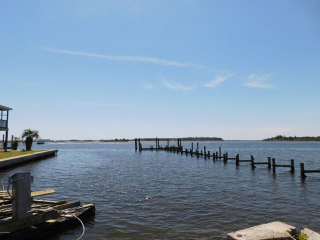 EXCELLENT WATERFRONT LOCATION ADJACENT TO BEAUTIFUL HISTORIC DOWNTOWN SWANSBORO!THIS HOME WAS FAMILY COTTAGE, BEING SOLD AS-IS, LOTS OF POSSIBILITIES....VIEWS OF THE WATER AND ICW ARE PANORAMIC, DOWNTOWN WATERFRONT SWANSBORO STEPS AWAY, BEAUTIFUL NEIGHBORHOOD WITH EASY WATER ACCESS AND MORE.