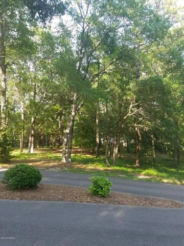 Wonderful bargain in a beautiful wooded, waterfront, gated community. River Run has a great community fishing pier on the Lockwoods Folly River, nice community pool and clubhouse, and lovely treed streets. X zone, no flood insurance required. Septic permit for a 3 bedroom home has been paid for. The community parking area for RV's and Boats is secure. Trailer your boat 2.8 miles to Sunset Harbor and put in at public access bulkheaded docks, where the inlet to the ocean is approximately 1.5 miles away. The new Lowe's Food Store shopping center is only 9 miles from the property. Oak Island beach public access is just 13 miles from the property. What are you waiting for? Welcome Home. Seller is a Real Estate Broker.