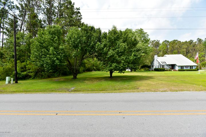 Come build your dream home! Just minutes away from local area beaches and this community is perfect for all your water activities! With a day dock and boat ramp this lot will keep you active for years to come! This beautiful land has been kept up. Open view of the road, near a wooded area in the corner. Perfect for privacy!