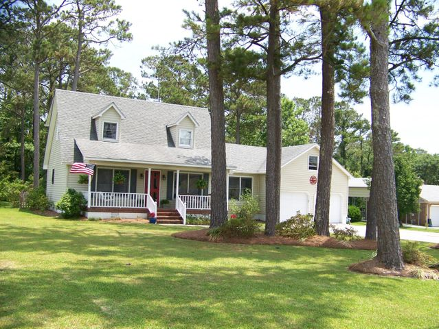 Just off highway 24! Lovely 3 bedroom home on gorgeous lot overlooking a boat basin leading to Bogue Sound. This Cape Cod design also features a large bonus area above the two car garage. Large pine treesdecorate the beautifully manicured front yard. Fenced backyard for children and pets. Roof replaced in 2014.  Boat Ramp within a stones throw. You should see this one!