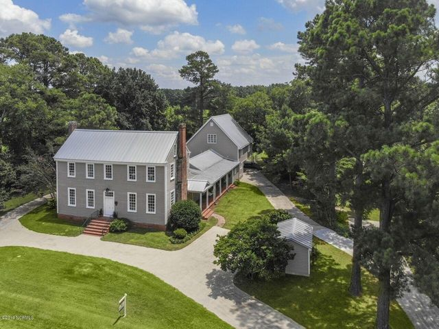 The Historic Scarborough Plantation, built in 1821, features 7 separate buildings all with commercial metal roofing situated on 2.72 acres. In addition to the 6,038 sq. ft. main home, there is a guest home offering 2,463 sq. ft., a separate pool house, pool, garden shed, barn & covered stalls for events, workshop use or hobbies. Quarantine here involves making a zipline, building a fort, a greenhouse, and polar plunging in the pool after playing baseball in the field. Virtual tour link included!