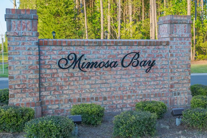 Build your next home in the gated community of MIMOSA BAY! This beautiful lot is located in the cul-de-sac of a neighborhood that offers a boat ramp/day dock, club house with gym, tennis courts, pool, play ground and boat/RV storage lot. Mimosa Bay is located close to the Intracoastal Waterway, the beautiful beaches of Topsail Island and Camp LeJeune.