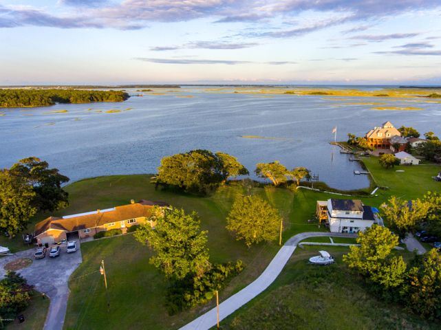 Looking for panoramic Intracoastal Waterway views (ICWW)?   High bluff lot with deep water, at mouth of Queens Creek. Expansive views out to Bogue Inlet. This is a rare find for deep water, large lot , HUGE views! Come look today and plan your dream home. There is not a lot like this left! Great Opportunity ! There has been a 4 bedroom septic evaluation with a probability to obtain a 5 bedroom permit with low flow fixtures engineering. Go view and make your dreams a reality! No HOAs!