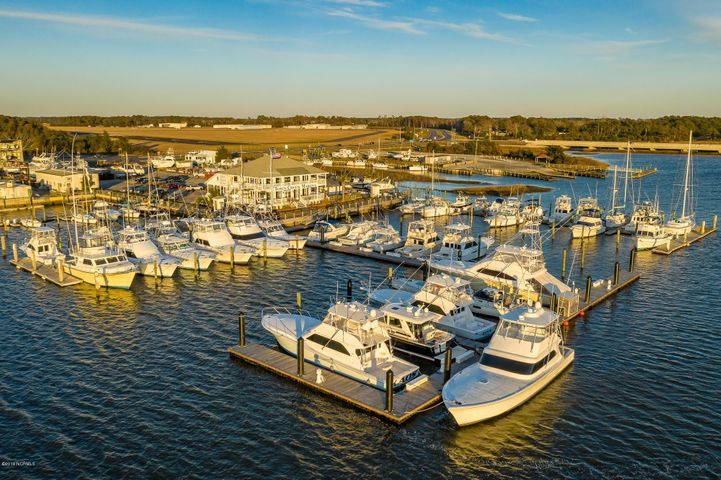 This slip is currently reserved; Town Creek Marina Boat Slip D-45 is a 35' slip which is located in the only full service marina in Beaufort. Easy access to the Beaufort Inlet, the ICW, sport fishing and recreational waters. Top quality floating docks, shore power (30/50/100 amp), Ship's store, softened water, bathrooms, showers, laundry facilities, bulk ice, diesel and gas fuel plus much, much more! See the Special Features sheet under documents. Enjoy your time on the water then dine in style at City Kitchen which is the on-site restaurant and waterfront bar. Town Creek Marina is also proximate to the downtown area of historic Beaufort for additional dining, shopping and entertainment. The Town Creek Marina boat slips were condominiumized in order to convey ownership as real property; each boat slip has been assigned a tax parcel number and will be conveyed by a deed.