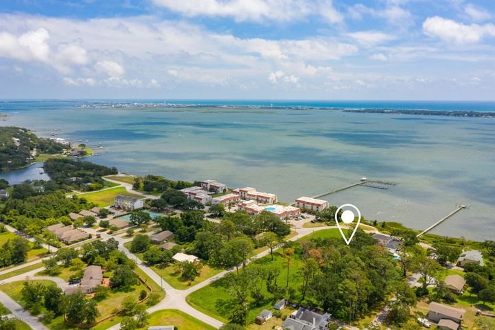 Beautiful lot across from Bogue Sound in the established Morehead Bluffs / Mitchell Village area of Morehead City.  This area is convenient to shopping, schools, hospital and employment facilities. Generally level lot that has been cleared and is ready for your dream home! Mitchell Village offers a wonderful playground and picnic area on Bogue Sound within a block of this lot.