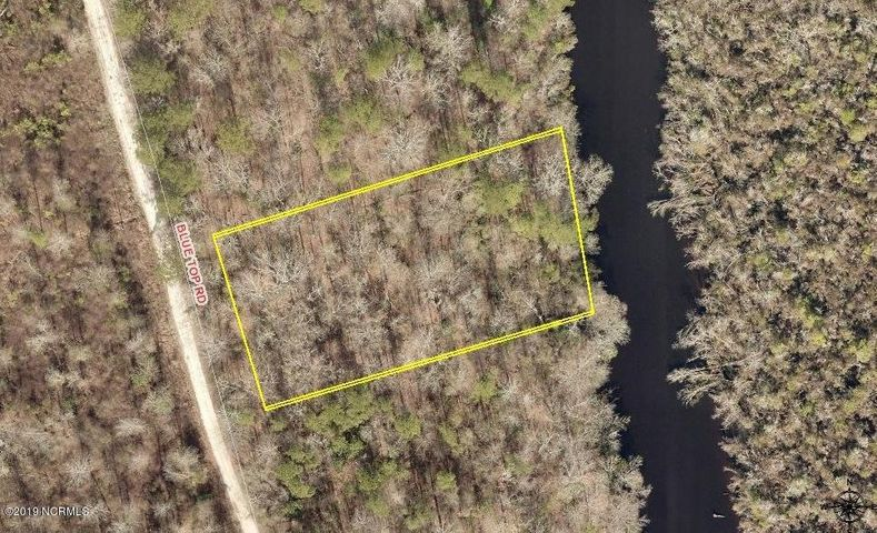 Residential building lot for sale!  Located outside the Jacksonville city limits, this creek front lot is a great location for you to build your new home!  Lovely, quiet neighborhood.  Lot is located near the end of street at cul-de-sac.  Call today for more information.