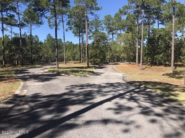 Private, spacious home site in SeaWatch - a new community on the Intracoastal Waterway centrally located between Southport/Oak Island and Wilmington featuring a kayak/canoe center and miles of nature trails, with plans for a marina, clubhouse, fitness center, swimming pools and more! The lot is partially wooded and sits on over 1/2 acre of land, perfectly situated on a cul-de-sac.