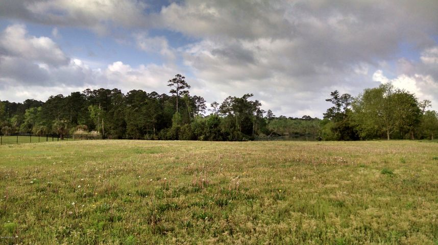Motivated seller has reduced their asking price on this residential lot just outside the Jacksonville city limits.  Close to all that Jacksonville has to offer without the city taxes to pay!  Full acre lot with bulkhead on navigable water.  Lot fronts Northeast Creek and is just three miles from Marine Corps base.  Build your forever home or weekend getaway here!