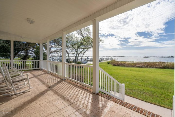 PRICED $225,000 BELOW RECENT APPRAISED VALUE! You've been waiting on a steal of a deal for a navigable waterfront home in coastal NC and here it is! Imagine watching the sun rise over Topsail Island, heading out to catch a few fish after coffee, and watching your loved ones play in the grassy yard while you prepare dinner or tinker in the huge garage! Take a private tour from the comfort of your home with the 3D Matterport Tour... walk all through the house and see every detail, angle, and finish! With its 4 bedrooms, 3.5 baths, and boasting over 4400 heated square feet, this like-new luxury home is situated on a waterfront 1.67 acre lot overlooking the ICWW across Chadwick Bay. The chef's kitchen is equipped with brand new KitchenAid appliances, including a cooktop electric stove, wall oven, warming drawer, dishwasher, & fridge, all with transferrable warranties. The walk in pantry can hold enough supplies to feed a small army, and the butlers pantry can showcase your wine collection and keep it chilled.The formal dining room seriously has a million dollar water view. The ground level owners suite is fit for royalty with a soaker tub, large walk in tile shower & a walk in closet with ample built in shelving and drawers on an HGTV level. Two other bedrooms share a full bath, plus there is a powder room for your guests. Upstairs you'll find the 4th bedroom with a connected loft that might be perfect for a reading nook, meditation space, or exercise spot. The recreation room has a wet bar, complete with a mini fridge for snacks and drinks, and it would be a great game room or private home theater. The detached 3 car garage could be a great workshop, mechanics retreat, or hold your favorite muscle car. It comes complete with an air compressor & hose system, and plenty of room for tool boxes or equipment.  But wait, there's more... There's a front bonus room in the garage that would be a great office, den, or display room, plus the whole upstairs is storage area! The one car detached workshop/shed holds the lawnmower and yard tools, keeping that showroom garage clean and tidy. The lawn feels like carpet under your bare feet, and the landscaping is mature and changes with the seasons. The laundry room is on the ground level with a utility sink, & both the washer & dryer convey. This property offers impeccable water views from nearly every angle and room, including the multiple covered decks, screened porch, & open patios. The owner has an expired CAMA permit on file, but you have the choice of setting up your boat dock and slips how YOU want it! Extra features include warranties on windows (and many other things in the home that will transfer), irrigation system, security system, landscape lighting, NO HOA, & NO city taxes.. There is a Supreme Level 2-10 Home Buyers Warranty offered with the home for extra peace of mind. The owners have earnestly maintained this home, and diligently oversaw the renovations done. Call a Realtor for more information on this home!