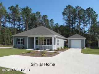 Pre-construction offering of a three bedroom, two bath ranch style home with detached single car garage.  Quality built with low maintenance vinyl siding.  Interior features include LVT flooring, granite counters and appliance package.  Great location in the fast growing community of Sneads Ferry.   Access to the beaches of Topsail Island less than 10 minutes away and 15 minutes from the back gate at Camp Lejeune.  Identical adjacent home available to be toured, act now and pick your decor and finishes.