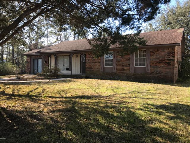 Spacious brick ranch in Boiling Spring Lakes, being sold as-is, so you can make it your own. So much potential with this 3BD/2BA home offering: Living Room, Dining Room, Kitchen, Den & Sunroom. Flat yard with 2 outbuildings.