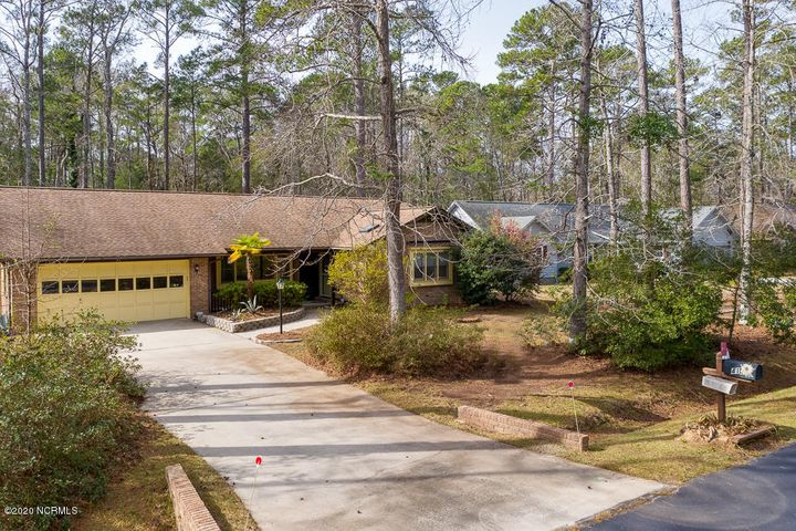 Well maintained home in fabulous Carolina Shores. Huge living room with triple window for tons of light, leads to a spacious dining room. And both bathrooms & the kitchen have skylights to bring in even more light. Kitchen with ceramic tile floor is open to the den with gorgeous hardwood floors & gas log fireplace. And an enclosed porch/sunroom, not included in square footage, lets you enjoy 3 seasons overlooking the private back yard. New a/c units  installed in late 2018.