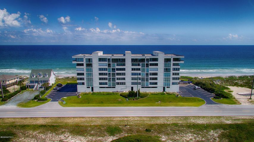Oceanfront condo with views that will take your breathe!!  A semi private elevator will take you to this 3 bedroom St Moritz condo offering you beautiful ocean views with floor to ceiling windows and water views from every room! 2 bedrooms offer carpet and the rest of condo has beautiful tile floors, for easy cleanup.  The master bedroom offers floor to ceiling windows to allow for phenomenal unobstructed sound view and  bath offers a walk in tile shower !  The second bedroom offers ocean and sound views and opens to an enclosed sitting area with a daybed! There's a separate laundry room with new washer and dryer in 2018; the a/c and hot water heater were also replaced about that time.  Assigned covered parking, storm shutters, offer extra protection and safety from the weather!  There is private locked  storage in the foyer area off the elevator and just off the oceanfront balcony! Take a break in the 6th floor clubhouse and gym where you can exercise, gather as a group, take a sauna, all while still enjoying the awesome views!! YES pets are allowed!   Beach living has never been so easy!!  Come take a look today!