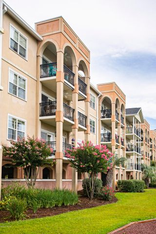 Why this condo? Because the sellers are offering a $2,000 bonus to buyer if offer is accepted before April 3rd, 2020!! And It is in pristine condition & is the popular 2A floor plan in The Preserve. The 2A plan features a large main living area creating multiple decorating options.  This unit offers an over sized front patio area that is only available on first floor units in the development. Enjoy direct Intracoastal water views from the living area, master bdrm and large balcony. Gleaming 6 inch plank real wood floors cover the living area, tile floors in the kitchen and bathrooms, neutral carpet in the bedrooms. Granite surfaces in the bathrooms, walk-in shower and large soaking tub. Granite counters in the kitchen. New Washer and Dryer convey. Why the Preserve? Because it's a wonderful community with a great clubhouse, pool and fitness center located on the Intracoastal waterway on the mainland at the foot of the bridge to Oak Island's East end. Golf at Oak Island Golf Club. Fly your personal aircraft into Cape Fear Regional Airport. Harbor your boat at nearby Marina's. This is living. You worked hard for it, you earned it, you deserve it! What are you waiting for!