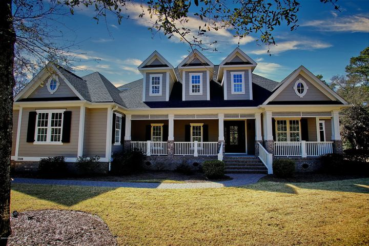 Built in 2015, nestled in a park-like setting find this absolutely stunning home built by Whitney Blair, Builder of the 2017  Southern Living Idea House on Bald Head Island. Extensive millwork, floor to ceiling wainscoting, coffered ceiling, trey ceilings, crown molding, mantle mill work, arched casement mill work. Wood floors throughout except bathrooms and laundry room, which are tile, and the enclosed sun porch which is luxury vinyl plank flooring. Carrera marble solid surface countertops. The french panes are truly divided light panes, not single panes of glass with removable grids. The rocking chair front porch invites you to have a seat. Relax in the newly built enclosed sun porch which is heated and cooled making it a room for all seasons. Enjoy your favorite music through the surround sound in every room. 5 TV's and Sound system accessories convey.Every single detail was considered by the sellers when they built this home. The photos do not do it justice. You really need to walk through the generously apportioned rooms to appreciate the size and beauty of this home. Bright and cheerful rooms. A large 1st floor office with full bathroom provide a quiet, private work space. A large open seating area leads to the second floor guest bedrooms. Seascape at Holden Plantation is a beautiful Intracoastal waterway community, with amenities that include a secure storage area for your ''big toys''. A marina with deeded boat slips and two loading ramps, a picnic area and marina house with fish cleaning station, kitchen, ample seating and bathrooms. The main clubhouse features indoor and outdoor pools, sauna, kitchen, library/card room, meeting/ entertainment room, and state of the art fitness center with showers and changing rooms. A beach clubhouse, located on Holden Beach, has outdoor showers, restrooms, parking, kitchen, fireplace, and a lovely rocking chair porch. A beach clubhouse, located on Holden Beach, has outdoor showers, restrooms, parking, kitchen, fireplace,