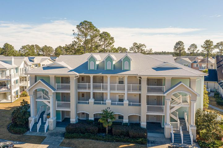 Immaculate condo located in the beautiful gated community of Brunswick Plantation & Golf Resort! This condo has all new carpet, tile, paint, appliances, and furnishings. Ready to be your getaway spot or a terrific rental property or both!! It is a one-bedroom/one-bath condo, with a separate lock-out unit with another bedroom/bath and kitchenette, so that you can rent or use both units together or separately. Fabulous location overlooking the community pool & volleyball court, and convenient to the clubhouse. Amenities include 27 holes of William Byrd designed championship golf, swimming pools, stay-fit facilities, tennis, walking trails, and 2 plantation-style clubhouses.  Also enjoy our on-site restaurant, the 19th Hole, serving breakfast and lunch. Just 15 minutes to beautiful Sunset Beach and 30 minutes to Myrtle Beach, SC.