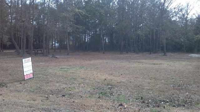 Located across from the intracoastal waterway in an established neighborhood. A new home would have a beautiful view! The lot has perked for a 4-bedroom septic.
