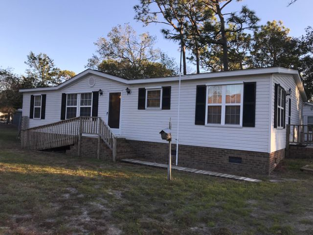 Are you ready for your very own beach getaway?? This well maintained home on a convenient street, within walking distance to the beach is ready for you to move in! Open, bright kitchen with island, and dining area. Huge living room, spacious master suite and 2 more bedrooms and another bath. Outside offers several storage buildings, an outside shower, that just needs to be hooked up, AND an adorable gazebo to relax after a long day at the beach!