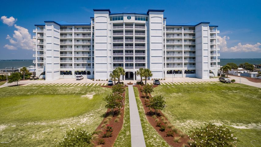 Epic waterviews from this 3 bedroom, 3 bath, soundfront condominium in The Nautical Club! Top floor, end unit which is the largest floor plan within this project -- this condo offers unobstructed views of Bogue Sound and the ICW from most rooms and the wrap around balcony, ALSO, oceanviews from the covered porch on the southside. Beautiful, top quality details such as: granite counters, tiled baths, luxury flooring in living area, tray ceilings, crown molding, accent lighting, walk-in closets and a gourmet kitchen.  The Nautical Club offers wonderful amenities: outdoor pool, 8th floor clubhouse, fitness room, game room, library, event room, boat ramp, kayak launch, on-site boat storage and a recently completed new pier on Bogue Sound.