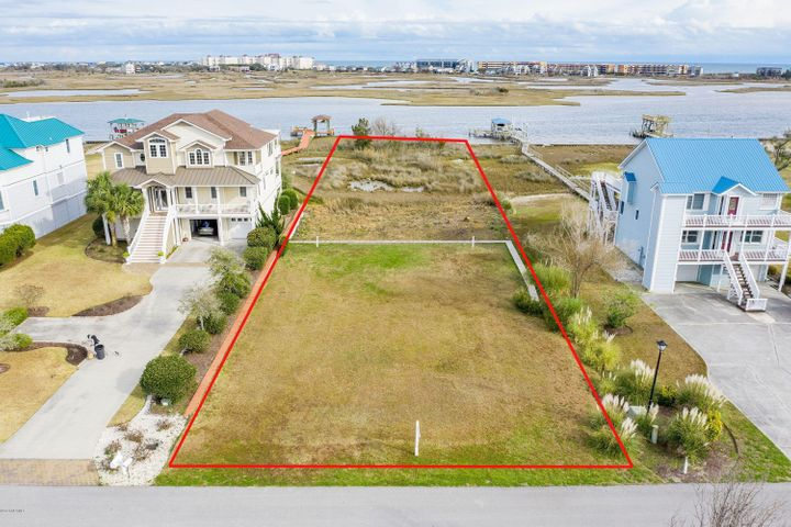 Beautiful lot directly on the Intracoastal Waterway in the upscale community of Pelican Point. The site work has been done. This waterfront lot has been cleared, filled and bulkheaded. It's ready to go! Paid 3 bedroom sewer tap in hand. A dock is possible with proper CAMA permitting. You'll have incredible water views all around with the ICW and Topsail Island on one side and Chadwick Bay on the other.Federal Flood insurance available.
