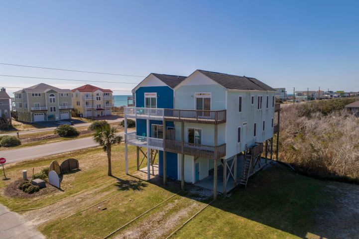 Spectacular 4 bedroom 3 bath second row beach home on a large corner lot is on the market!!  Topsail Island luxury living for a get-a-way beach home or this will make a fantastic rental.  Enjoy gazing into the evening sunset off either side of the multiple decks.  This home has both ocean and sound side water views.  No matter which room you find yourself you will enjoy the abundance of natural lighting throughout this spacious home.  The open floor plan on the primary level is perfect for family gatherings, reunions with friends or just a quiet night sitting on the deck catching up on your reading.  The combination kitchen is equipped with stainless steel appliances, granite counter-tops with high top counter for additional seating with bar stools.   Don't miss your opportunity to own your piece of Topsail Island.   Scheduled your viewing today!!!