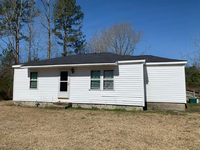 Country fixer home on 9 acres near a stream. Two (2) bedroom house that needs total rehab and after can be used as a second home, investment property or rental. Additional unheated mud room - 7 X 19' not counted in square footage.  Home did not flood during Florence. Pender county water. Value priced opportunity on this wooded lot that is partially cleared. Short drive to Topsoil Island and Hampstead.