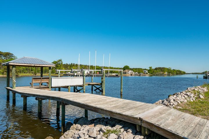 Join the idyllic coastal community of Stanton Landing with the purchase of these two lots as one package: 110 Waterway Drive is a prepared building lot and across the street is your private waterfront gazebo with 2 boat lifts in place and ready for you to begin living the coastal lifestyle. With deep water, a bulkhead and a deeded dock, this is a perfect setting for boaters or anyone who appreciates the peaceful scenery --swimming dolphins, sunsets and yachts cruising the ICW.  Situated in Stanton Landing with 2 boat lifts and waterside gazebo (20,000 lb with remote and 10,000 lb with remote) -- this lot is ready for your coastal home! Seller has prepared everything and in the documents you will find: Tax Information, Deeds, Septic Information, Key Features, HOA Information, Survey, Proposed Footprint for house plans (or pick your own plan) and all other disclosures. Private well on-site accommodates both lots and a septic permit in hand for 3 Bedrooms. Stanton Landing offers a community clubhouse, swimming pool, street lights, road maintenance, boat storage area which is fenced/gated and a boat ramp for small craft. Enjoy living the coastal and boating lifestyle: easy deep water access, boats cruising on the ICW, tasteful homes, pristine scenery and landscaping. Close to shops, dining and downtown Beaufort, too.