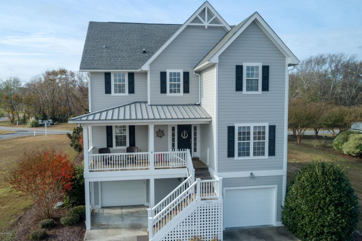 This spectacular home offers magnificent views of the ICW and the St James Marina. A well thought out plan welcomes you with a wide front porch and an open 2 story foyer. The main level has a stunning, open living, dining and kitchen area, that opens up to a fabulous screened porch and deck for entertaining. And finishing the main level is a guest bedroom and full bath that can be an office as well. Upstairs is a spacious master suite that also opens up to a cozy deck to enjoy your morning coffee. This home also offers a garage and workshop, and an elevator making this home accessible to everyone.