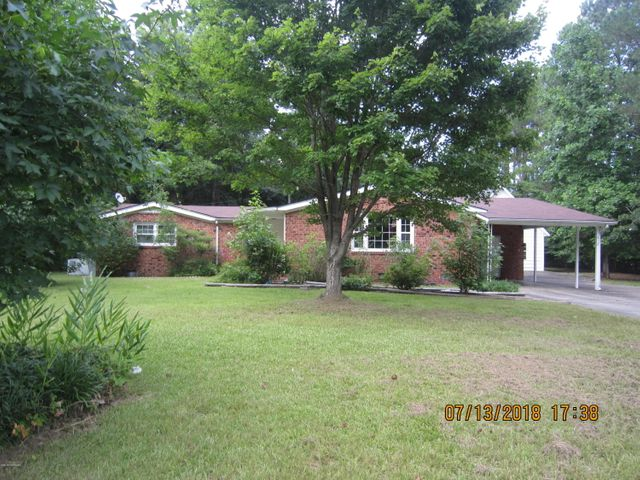 Looking for a fixer upper?  Brick ranch with over 1700 heated square feet, 3 bedrooms, 2.5 bathrooms, updated kitchen with all stainless steel appliances, 2 living rooms and a detached garage with storage upstairs. This home is situated on over 1/2 acre and is ready for a new family. Home has mold and soft floors, condition poor.