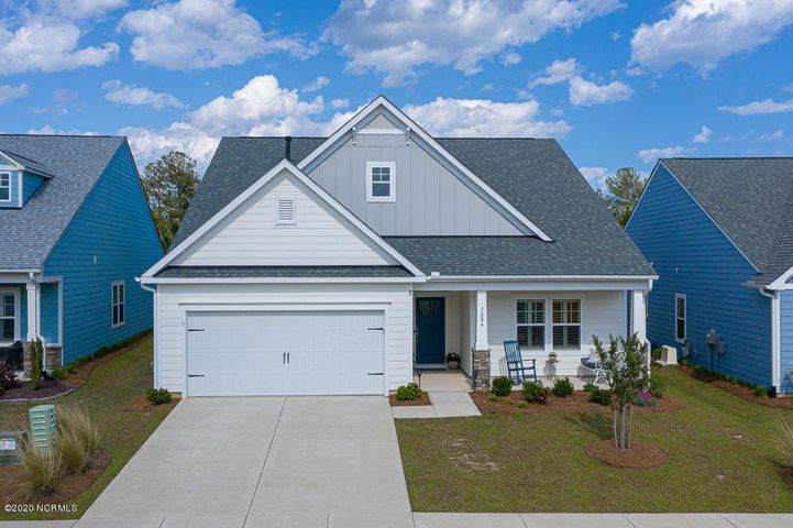 Gorgeous, one-level home in one of Brunswick Forest's newest communities with all the bells & whistles! This home was built in 2018 and features a modern, open living space with a gourmet kitchen, recessed lighting, architectural beams and a gas-log fireplace.  The house also boasts a stunning outdoor sunroom (not included in the SF) with insulated shades and a wide, inviting front porch.  There are almost too many upgrades to mention - including granite countertops, a luxurious master bathroom, a custom-designed walk-in closet from the master bedroom, engineered wood floors, beveled crown moldings, plantation shutters, and more.  This is a perfect house in a desirable community with miles of walking trails, three outdoor pools/one indoor, tennis courts, a full-service fitness and wellness center, kayak/boat launch and more.