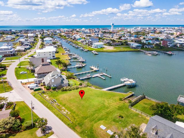 Deep water canalfront lot in a prime, protected location on Bayview Blvd -- easy access to Bogue Sound, the ICW, recreational and sport-fishing waters! Bulkhead, pier, dock and 2 boat lifts (5,000 lb and 10,000 lb) already in place. Bring your plans and build your coastal dream home today. See a recent survey outlining the specifics of this lot under documents.