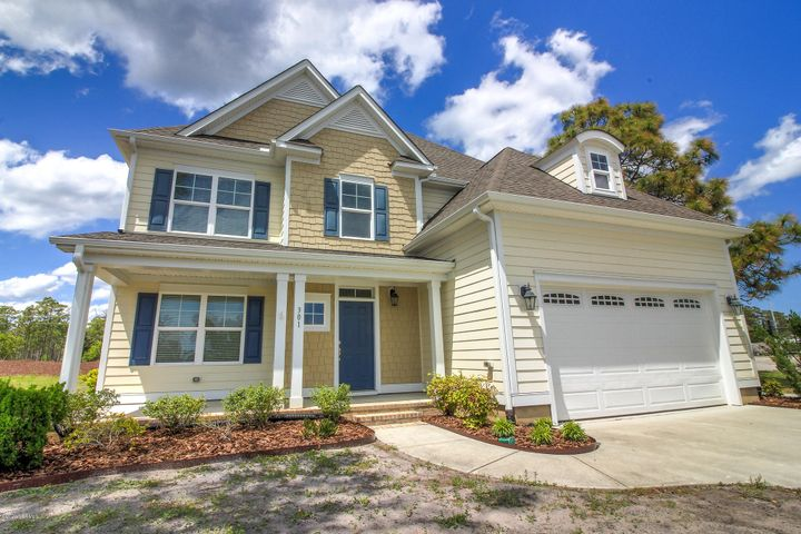 Located in a beautiful waterfront subdivision on Hwy 24 sits a spacious home with grand details in Bogue Watch.  Enter inside the two-story foyer to discover arched entryways, and large living areas on the main living level, including an office space.  The kitchen has granite countertops with bar seating, stainless appliances, and a large walk in pantry.  Plenty of light leads into the formal dining area with coffered ceilings, crown molding and pre-engineered wood floors.  Living room is open and there is also a carpeted den/sunroom area.  All spaces are open and flow into each other.  This home uses natural gas, from the stove, to the water heater, heating, and fireplace.  Upstairs is a landing area, laundry space, and a magnificent master suite with tray ceiling and seating area overlooking the back yard.  Master Bath includes not one, but two walk-in closets! Stand up shower and a soaking tub make this the ultimate in relaxation.  Upstairs are three more nicely sized bedrooms with a full bath.  Neighborhood amenities include:  boat ramp, kayak launch, observation pier, pool, playground, and clubhouse.  All of this and located in the Croatan school distract with a short distance to military bases and beaches. Marina and boat storage available for additional charge.