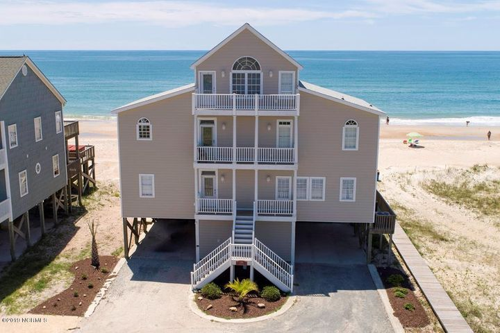 You will find little missing in this Oceanfront home with a pool!  6 spacious bedrooms, 2 of which are master suites w/ 6.5 baths,  and all 3 floors and every room overlook the ocean! The 2nd floor has a huge great room with plenty of space available for the entire family. Everyone is a part of the conversation whether dining, lounging or preparing for a family meal.  Every bedroom has its own bath and you can walk out of every bedroom suite to a deck overlooking the Ocean  Relax and enjoy the hot tub off the first floor while looking at the ocean.  Per the seller - the siding is a composite called Everlast, all new and never needs painting. It is colorfast. Both heat pumps replaced in spring of 2020. Use the large decks for soaking in the sun, listening to the waves or just hanging out! Well appointed, this is the perfect investment property with over $125k in gross rents for 2019 and $131,225 as of August 5, 2020! This property already has $114,105 booked for 2021 and it's Just January 2021!!!