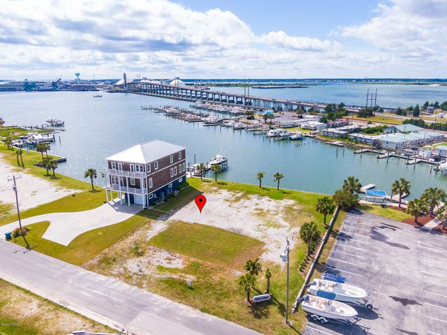 Great location and gorgeous views from this waterfront lot with deep water access in the newly developing Tide Lines Subdivision. This lot is ready for your coastal dream home with a boat dock at your back door! Overlooking the Newport River, this premium location is just minutes to the ICW, the Beaufort Inlet and offers easy access to major recreational and sport-fishing waters. By boat or by land you are just minutes from the Downtown Morehead City Waterfront District to the west or Historic Beaufort to the east for restaurants, shopping or strolling the boardwalks. Municipal water/sewer services are provided by the Town of Morehead; the final plat map is under documents for 10' front and side setbacks, 30' rear setback from bulkhead with special exceptions for stairs and uncovered decks, see map for details. Your dream of living at the coast awaits - act today!