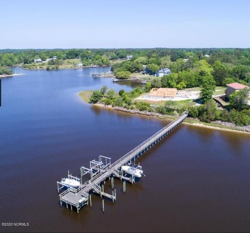 Deeded boat slip included with this largecorner lot located just off the ICW. Easy access to the inlet, ocean, or White Oak River.New lighted dock with cleaning station.Great waterview potential (tested by a cherry picker). Pretty lane access to small, quiet community-water, convenience, and close to beautiful downtown Swansboro! Irrigation well located on  back of property.